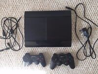 PS3 Super Slim 500GB with 5 games and 2 controllers