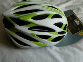 Brand new bike helmet, with tags, nice colour.unwanted gift,