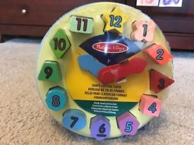 Brand new Melissa and Doug wooden clock in unopened package £7