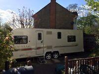 2012 Bailey Unicorn Pamplona Caravan, 4 Berth, Full Awning, island bed, twin axle, extras included