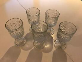 Five 5 inch mottled pattern wine glasses with thick patterned stem