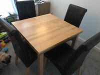 Extendable beech wood effect table and 4 faux leather chairs
