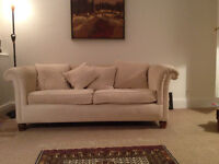 Three seater sofa in beige fabric, well-used, for quick sale.