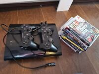 playstation 3, 2 controllers and 8 games