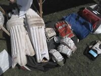 Selection of used cricket gear with a bag