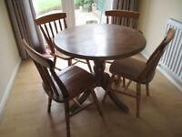 Round dining table and 4 matching chairs