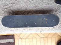 Plain skateboard with Enuff trucks