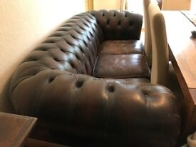 Vintage brown leather chesterfield sofa.