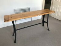 Industrial reclaimed oak table with cast iron legs