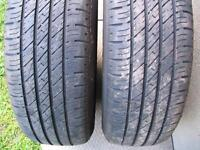Two tires on black GM steel rims 205/70/15 M+S