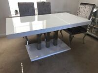 White gloss and chrome 6 seater dining table