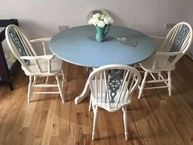 Beautiful hand painted shabby chic wheel back chairs and table
