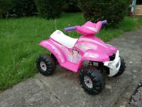 Child's electric (battery) powered pink quad bike.