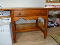 Beautiful designer table in antique cherry finish with single drawer at front & turned legs