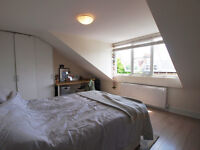 A stunning 4 double bedroom flat setover the top 3 floors ofperiod conversion moments walk from tube