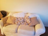 Cream sofa. Very comfortable. Removable washable covers. £40