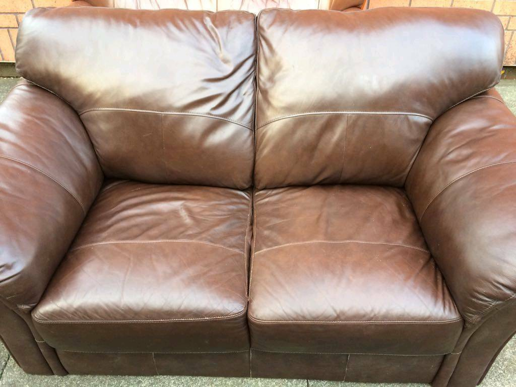 2 seate brown leather sofa