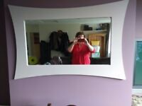 Large curvy mirror with wooden frame