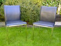 Pair of black steel chairs