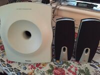 Speakers with amplified Philips woofer.