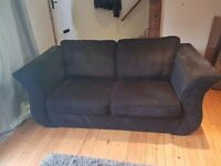 Black sofa and storage foot stool/poof