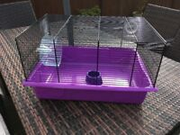 Hamster cage,with wheel and food bowl.Plenty of wear left in it.
