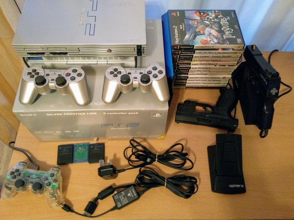 Ps2 Console Silver (orginal, boxed with two pads)