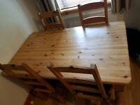 Farmhouse style pine dining table and 6 chairs