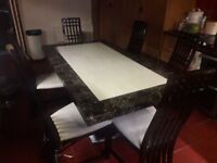 Patra by Harveys Marble dining table and six chairs.