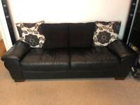 3/4 seater black leather sofa - sold subject to collection
