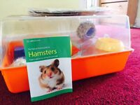Hamster cage with info book