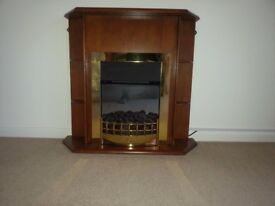 Electric fire with mahogany surround good condition
