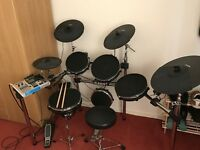 Alesis DM10 with mesh upgrade and Roland drum amplifier