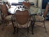 Round solid Glass Table with four Chairs
