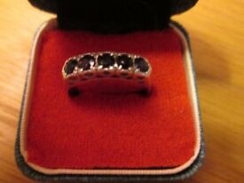 Lovely Sterling silver ring size N with 5 Sapphires