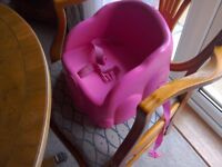 Child booster seat with safety straps.