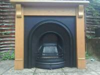 LARGE CAST IRON FIREPLACE AND SOLID OAK SURROUND