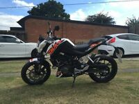 KTM DUKE 125 2014 1072 miles unmarked as new