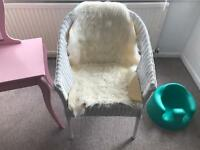 Wicker chair with sheep skin insert