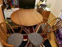 Ercol round table and 4 chairs