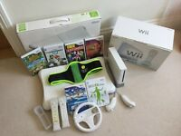 Nintendo Wii Console complete with Wii Fit Board and Games
