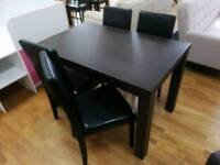 Walnut dining table and 4 black leather dining chairs