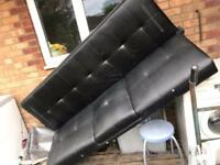 Black faux leather bed settee