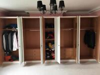 Fitted wardrobe, can be split into sections.