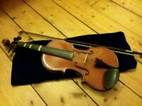Full size violin with selection of sheet music - perfect for learner