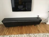 Black gloss TV unit with wooden legs