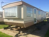 CHEAP static caravan for sale INCLUDING 2018 FEES/LOW ground rent/right next to the beach/swimming