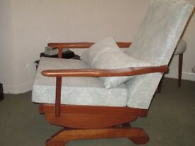 Rocking chair with wooden frame and upholstered seat and back