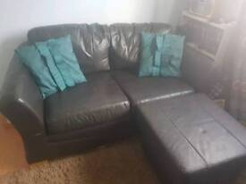 Two seater Brown leather sofa with footstool