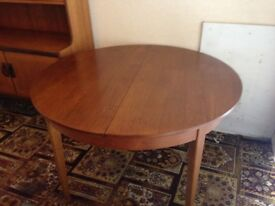 1960's teak extendable dining table with four chairs. Vintage teak table ideal for the family.